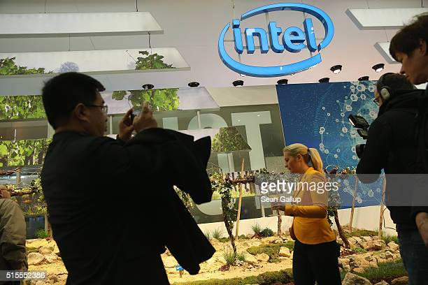 Visitors crowd the Intel stand at the 2016 CeBIT digital technology trade fair on the fair's opening day on March 14 2016 in Hanover Germany The 2016...