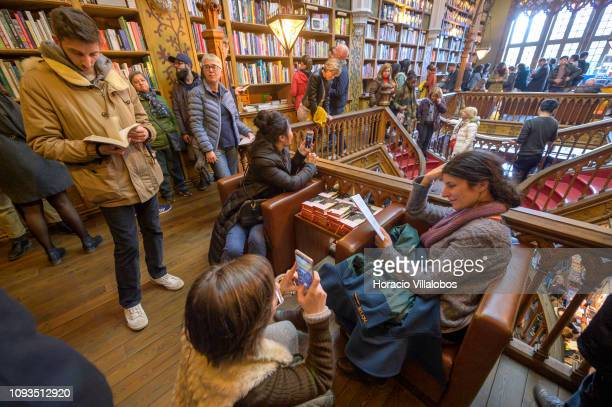 Visitors crowd the premises in Lello Bookstore on the eve of its 113th anniversary on January 12, 2019 in Porto, Portugal. The bookstore, a favourite...