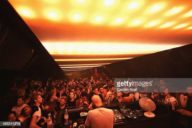 Visitors dance on the dancefloor to the music of a dj in the club 'Watergate' in Berlin Kreuzberg district on July 28 2012 in Berlin Germany This...