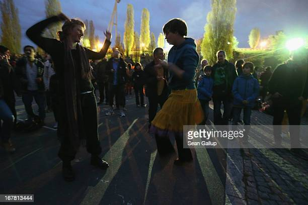 Visitors dance to an impromptu drummers' session in Mauerpark park on Walpurgis night on April 30 2013 in Berlin Germany Walpurgis night is...