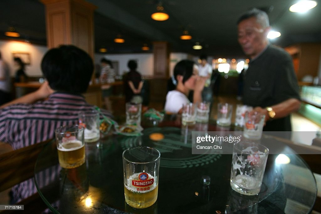 Visitors degust Tsingtao beer at a bar in the Tsingtao beer factory on August 25, 2006 in Qingdao, Shandong Province of China. Tsingtao Beer Group, China's biggest beer brewery and the Official Domestic Beer Sponsor of the Beijing 2008 Olympic Games, hosts the 16th Qingdao International Beer Festival in Qingdao from August 12 to 26.