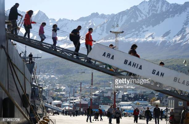 Visitors descend a Navy destroyer docked for visitor tours on November 5 2017 in Ushuaia Argentina Ushuaia is situated along the southern edge of...