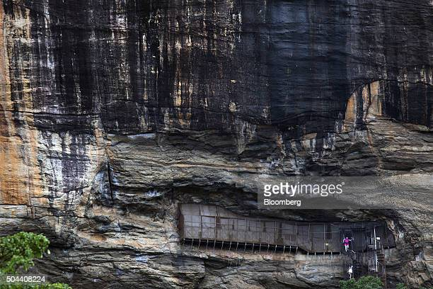 Visitors descend a spiral staircase at 'Lion Rock' in the Ancient City of Sigiriya near Dambulla Central province Sri Lanka on Tuesday Jan 5 2016...
