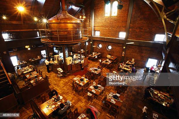 Visitors dine in the Kessel Hall at the Sapporo Beer Garden operated by Shinseien a unit of Sapporo Holdings Ltd in Sapporo Hokkaido Japan on Monday...