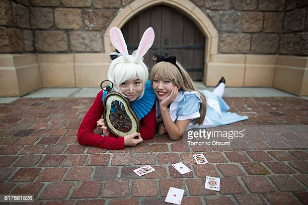 Visitors dressed as Disney characters pose for a photograph during the Disney's Halloween 2016 event at Tokyo Disneyland on October 25 2016 in...