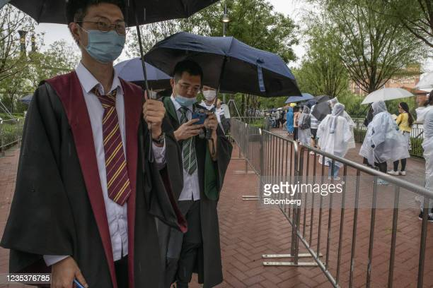 Visitors dressed as Harry Potter characters at the Universal Studios Beijing theme park in Beijing, China, on Monday, Sept. 20, 2021. The Universal...