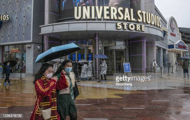 Visitors dressed as Harry Potter characters pass the souvenir store at the Universal Studios Beijing theme park in Beijing, China, on Monday, Sept....