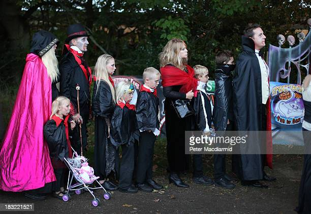 Visitors dressed as vampires line up to enter the Shocktober Fest at Tulleys Farm on October 5 2013 near Crawley West Sussex Each October thousands...