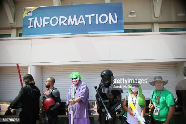 Visitors dressed in Cosplay costumes wait in line to enter the San Diego Convention Center during Comic Con International on July 20 2017 in San...