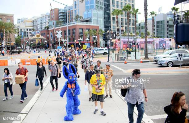 Visitors dressed in Cosplay costumes walk along the San Diego Convention Center during Comic Con International on July 20 2017 in San Diego...
