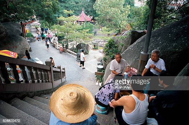 Visitors drink tea next to the stairs of the Nanputuo Temple in Xiamen. The Nanputuo Temple is located on the southeast of Xiamen Island. It is...