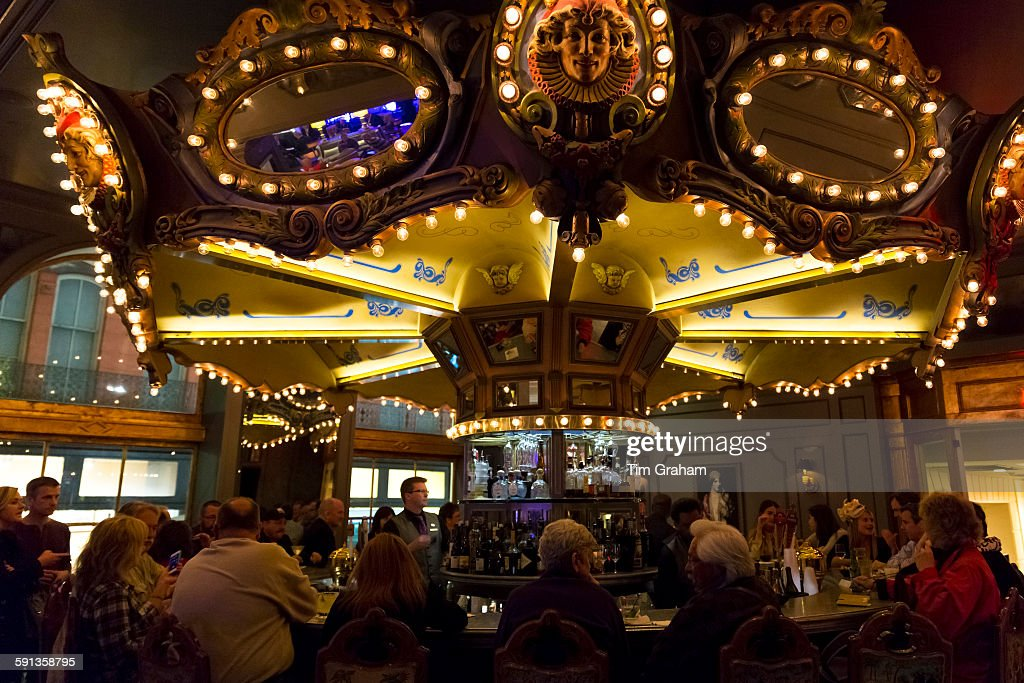 Visitors drinking in famous carousel bar lounge in Hotel Monteleone on Royal Street, French Quarter, New Orleans, USA