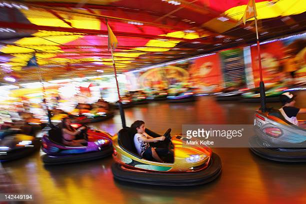 Visitors drive the dodgem cars in the carnival area during the 2012 Sydney Royal Easter Show at the Sydney Showground on April 5 2012 in Sydney...