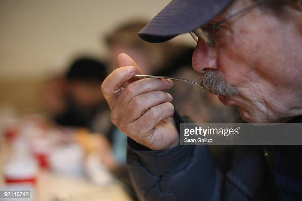 Visitors eat hot soup at a soup kitchen of the Malteser charity part of the Order of Malta Worldwide Relief on October 21 2009 in Berlin Germany...