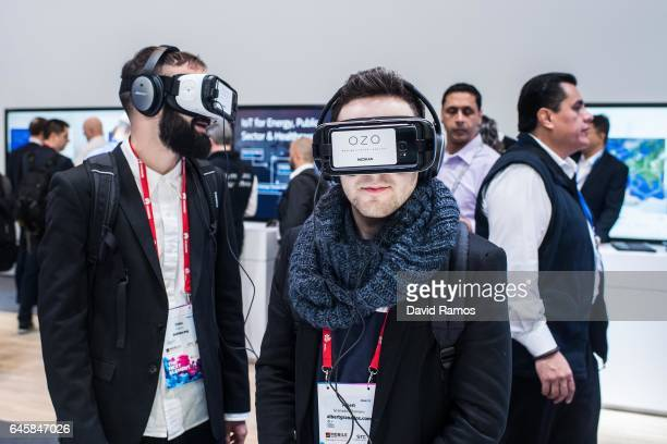 Visitors enjoy a Nokia OZO virtual reality experience during the Mobile World Congress 2017 on the opening day of the event at the Fira Gran Via...