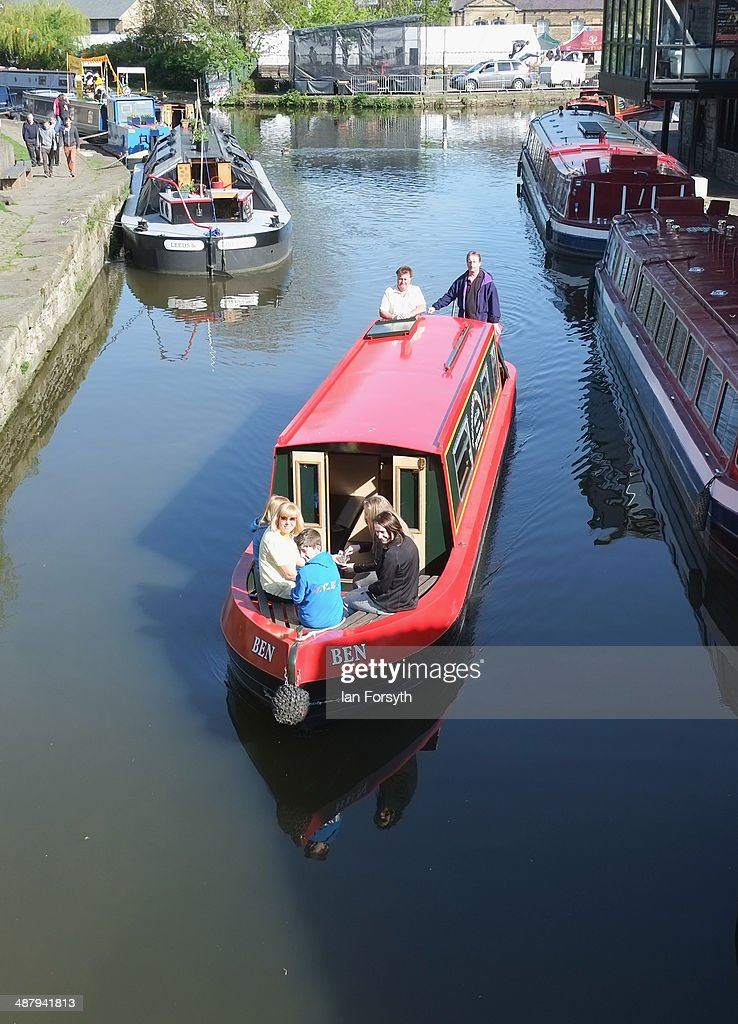 Visitors enjoy a ride on a narrowboat as they visit the Skipton Waterway Festival on May 3, 2014 in Skipton, England. The Waterway festival is a three day annual canal boat event held on the Leeds and Liverpool canal. The event brings together boaters and the local community who take part in the festival activities.
