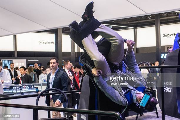 Visitors enjoy a Samsung VR virtual reality experience during the Mobile World Congress 2017 on the opening day of the event at the Fira Gran Via...