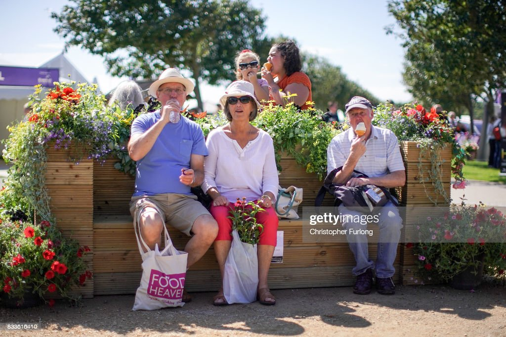Visitors enjoy an ice cream and the fine weather as they tour the flower displays at Southport Flower Show on August 17, 2017 in Southport, England. Today is the opening day of Southport Flower Show which is is held over four days. The event is the UK's biggest independent flower show, attracting 80,000 visitors each year to see the flora and fauna at Victoria Park.