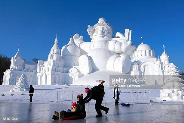 Visitors enjoy at Harbin International Ice and Snow Festival on January 5 2017 in Harbin China