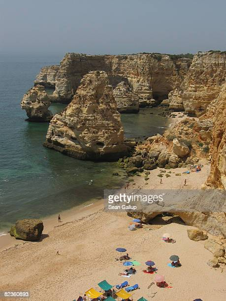 Visitors enjoy Marinha beach on July 30 2008 near Carvoeiro Portugal Portugal is becoming an increasingly popular tourist destination