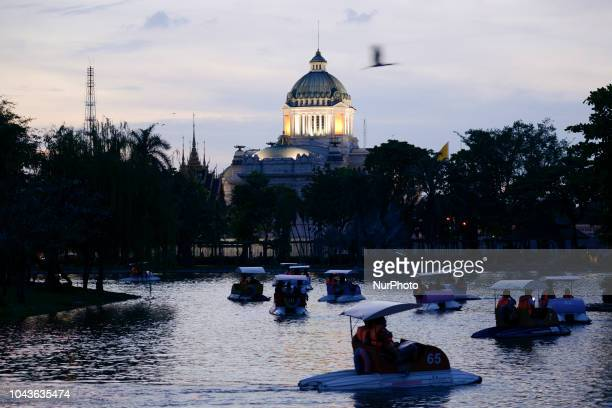 Visitors enjoy paddle boats as seen the Ananta Samakhom Throne Hall in the background at Dusit Zoo in Bangkok Thailand 30 September 2018 Dusit Zoo is...