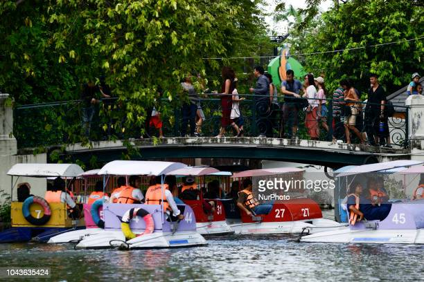 Visitors enjoy paddle boats at Dusit Zoo in Bangkok Thailand 30 September 2018 Dusit Zoo is Thailand's first public zoo opened 80 years ago on 18...