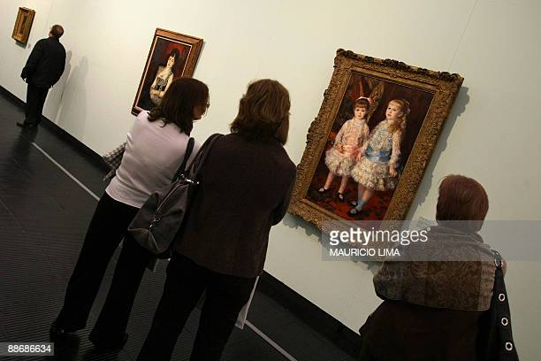 Visitors enjoy Pink and BlueThe Cahen d'Anvers Girls and Countess of Pourtales Portrait paintings both of French artist PierreAuguste Renoir during a...
