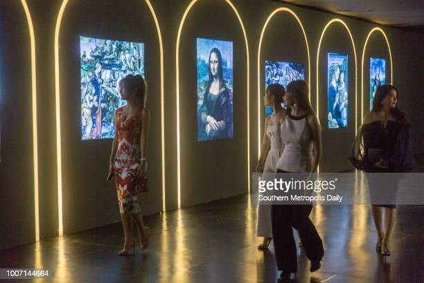 Visitors enjoy Renaissance Italian art through multimedia technology during the opening of 'Renaissance 2018 from art to heart' exhibition at...