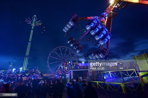 Visitors enjoy rides at the Hull Fair on October 11, 2021. - The Hull Fair, one of Europe's largest travelling fairs, returned after a break due to...