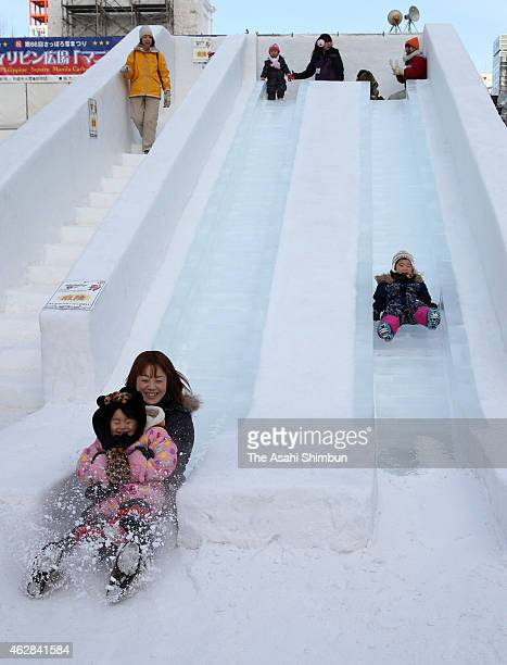 Visitors enjoy sliding during the 66th Sapporo Snow Festival at Odori Park on February 5 2015 in Sapporo Japan The annual festival expects to attract...