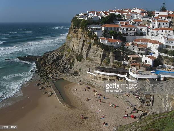 Visitors enjoy the beach at Azenhas do Mar on July 26 2008 near Colares Portugal Portugal is becoming an increasingly popular tourist destination