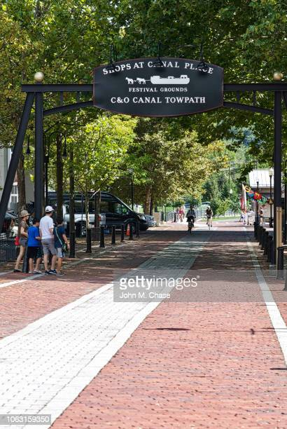 visitors enjoy the historic c&o canal towpath at its terminus in cumberland, maryland - cumberland usa stock photos and pictures