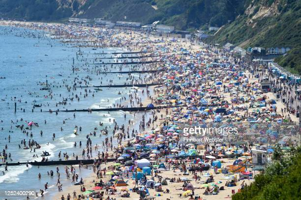 Visitors enjoy the hot weather on the beach on June 25, 2020 in Bournemouth, United Kingdom. The UK is experiencing a summer heatwave, with...