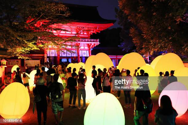 Visitors enjoy the illumination art of the 'Forest of Tadasu at Shimogamo Shrine' on August 17 2018 in Kyoto Japan