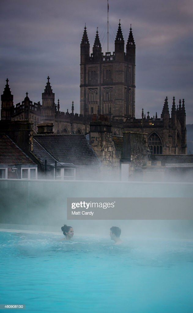 Visitors enjoy the naturally warmed spa water as they relax in the rooftop pool of the Thermae Bath Spa, Britain's only natural thermal on December 30, 2014 in Bath, England. Cold weather continues to grip the UK although forecasters have predicted a spell of much milder and unsettled weather will arrive for the New Year.
