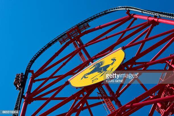 Visitors enjoy the new attraction 'Red Force' the fastest vertical accelerator in Europe during the opening day of Ferrari Land at the PortAventura...