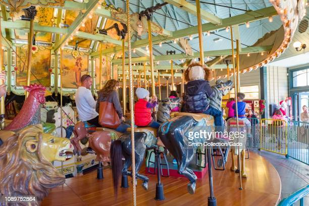 Visitors enjoy the restored vintage merry go round or carousel at Tilden Regional Park an East Bay Regional Park in Berkeley California December 27...