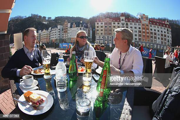 Visitors enjoy the sun at Rosa Khutor Mountain Cluster village on day six of the Sochi 2014 Winter Olymipcs on February 13 2014 in Sochi Russia