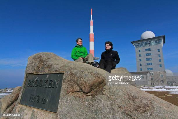 Visitors enjoy the sun on the Brocken the highest peak of the Harz mountain range in Germany 25 March 2015 PhotoMatthias Bein/dpa | usage worldwide