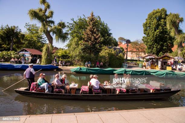 Visitors enjoy the sunny weekend day on a boat in the big harbour of Luebbenau in the region of the Spreewald Germany on May 27 2017 The Spreewald...