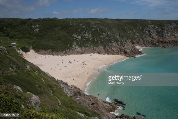 Visitors enjoy the weather as they visit the beach at Porthgwarra that was used as a location in the BBC's romantic period drama Poldark on June 13...