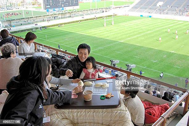 Visitors enjoy watching a rugby match in Kotatsu at Kintetsu Hanazono Rugby Stadium on December 8 2007 in Higashiosaka Osaka Japan