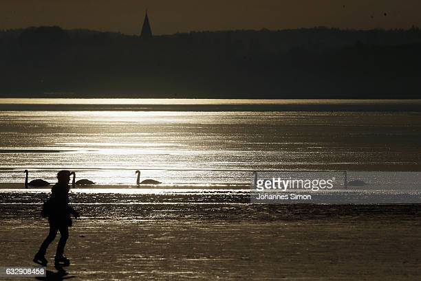 A visitors enjoys skating on Lake Ammersee on January 28 2017 in Stegen am Ammersee Germany After an unusual cold winter period currently most of the...