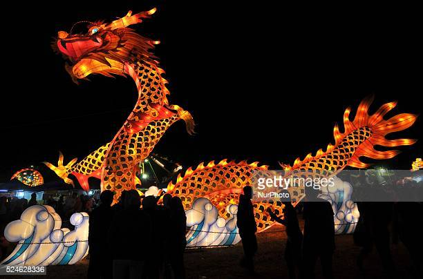 A visitors enjoys the festival of lanterns during celebrates Chinese MidAutumn Festival in Surakarta Central Java Indonesia on September 13 2014...