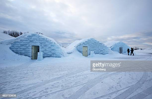 Visitors enter a room made from snow and ice at the Royce' Ice Hills Hotel in Tobetsu Hokkaido Japan on Sunday Feb 15 2015 The seasonal hotel opens...