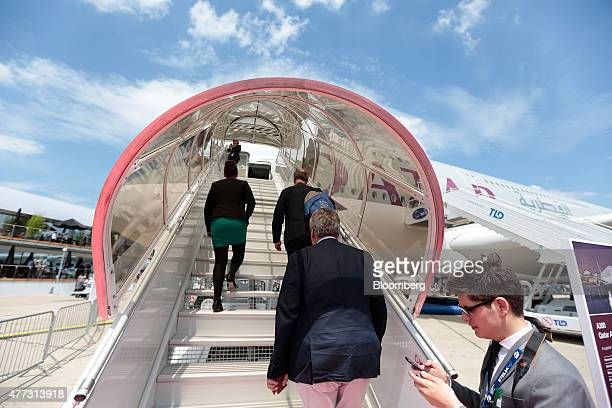 Visitors enter a stairway to access the forward cabin door on an Airbus SAS A380 aircraft operated by Qatar Airways Ltd on day two of the 51st...