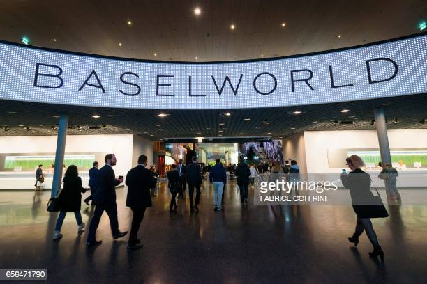 Visitors enter during the press day of Baselworld watch and jewellery show on March 22 2017 in Basel The world's biggest watch fair will open in...