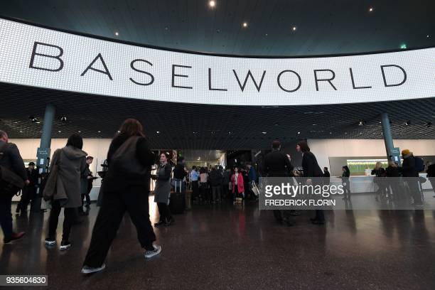 Visitors enter the Baselworld watch and jewellery show during press day on March 21 2018 in Basel Switzerland The world's biggest watch fair will...