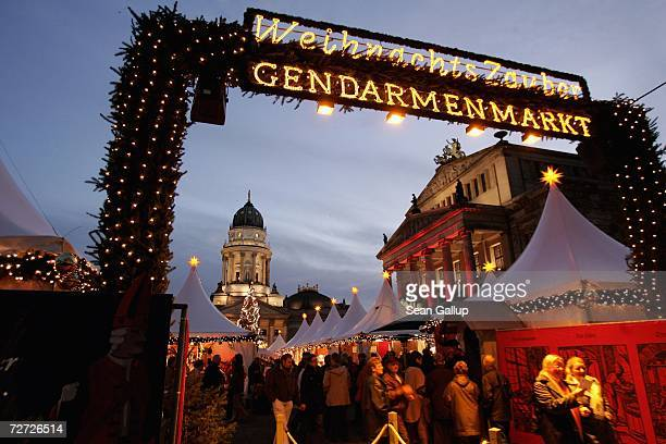 Visitors enter the Christmas market at Gendarmenmarkt December 5, 2006 in Berlin, Germany. Christmas markets are the highlight of the German...