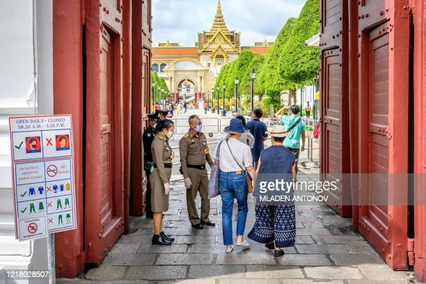 Visitors enter the Grand Palace in Bangkok on June 7 as it reopened for visitors following restrictions to halt the spread of the COVID-19 novel...